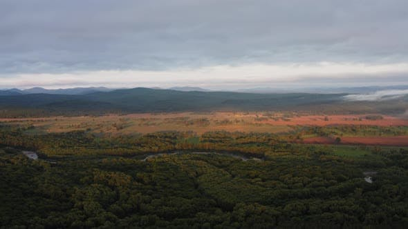 Aerial Drone View of Sunrise Over Misty River
