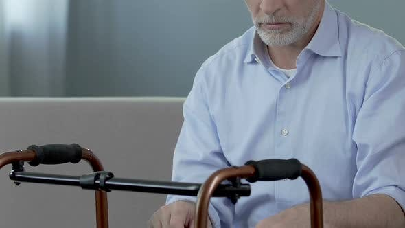 Thumbnail for Old Man Sitting and Looking at Walking Frame, Spine Trauma, Indecisiveness
