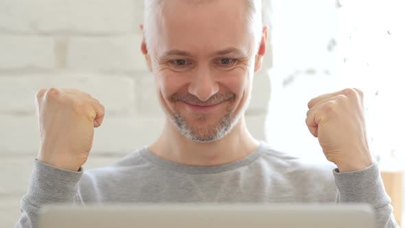 Cover Image for Middle Aged Man Excited for Success at Work, Front View