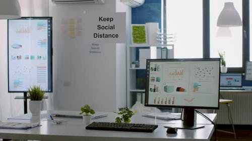 Modern Empty Office with Plastic Separators and Keep Social Distance Poster