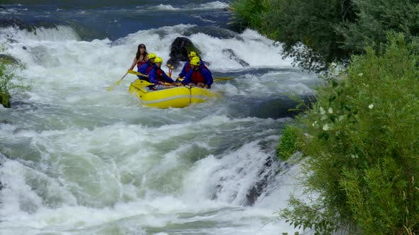 Thumbnail for Group of people white water rafting off waterfall