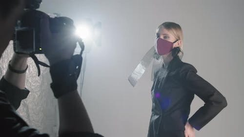 Female Model in Face Mask Posing for Photographer in Studio