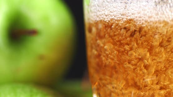 Pour Fresh Apple Juice Into a Glass.