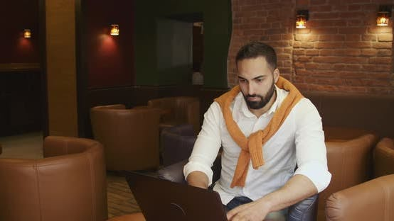 Thumbnail for Entrepreneur with Laptop