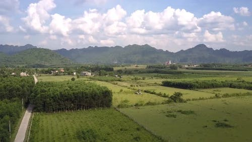 Landscape with Fields River Against Mountains Aerial View