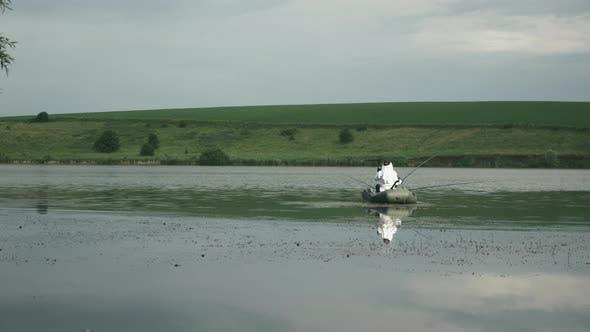 Man fishing on lake. Fisherman catching fish in lake or river water. Fishing on lake.