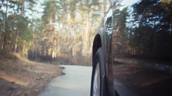 Thumbnail for Car Driving on Autumn Country Road. Low Angle Shot