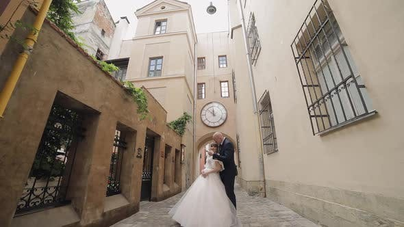 Thumbnail for Newlyweds in the Center of the Old City. Bride and Groom. Wedding