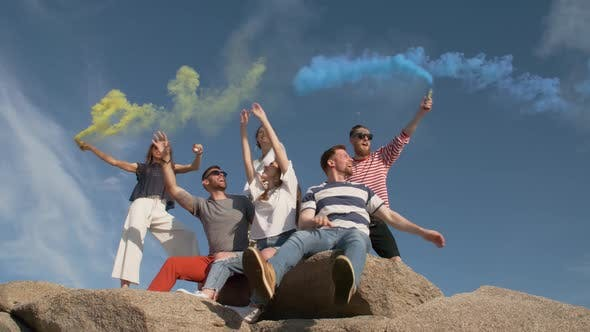 Friends Having Fun with Smoke Bombs
