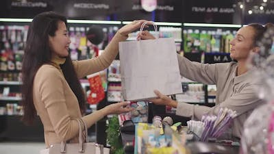Female Customer Buying Make-Up Products In Beauty Shop