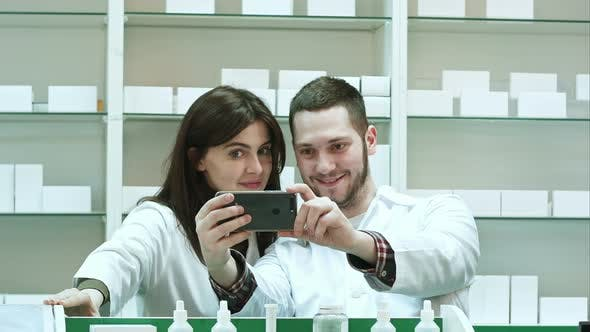 Cover Image for Smiling Two Pharmacist Taking Selfie in Pharmacy