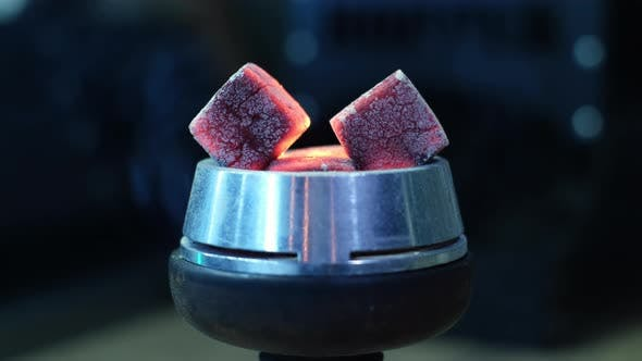 Hot red coals with hookah