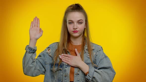 Sincere Responsible Teen Girl Raising Hand to Take Oath Promising to Be Honest and to Tell Truth