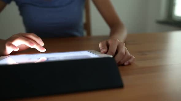 Thumbnail for Woman using digital tablet computer