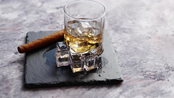 Thumbnail for Glass of Whiskey with Ice Cubes and Cigar