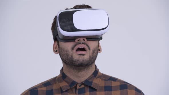 Thumbnail for Young Bearded Indian Hipster Man Using Virtual Reality Headset