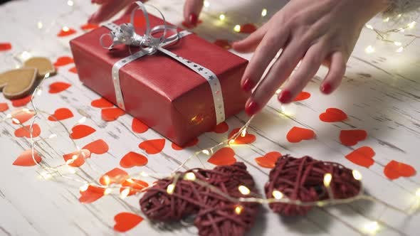 Thumbnail for Female Hand Taking a Gift Box From the Desk, Close Up