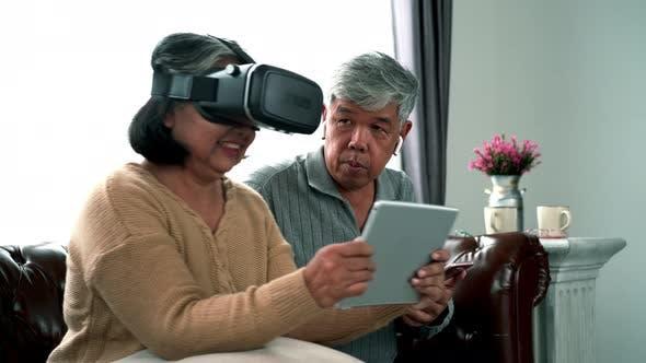 Thumbnail for Elderly Asian Using Modern Gadgets