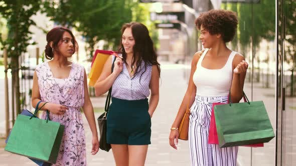Thumbnail for Happy Women with Shopping Bags Walking in City 1