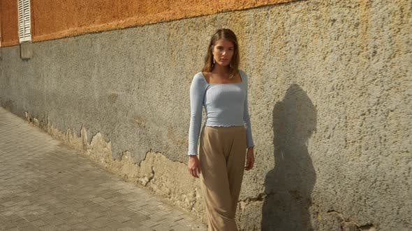 Thumbnail for Brown-Haired Model Walking by the Sidewalk on a Sunny Day