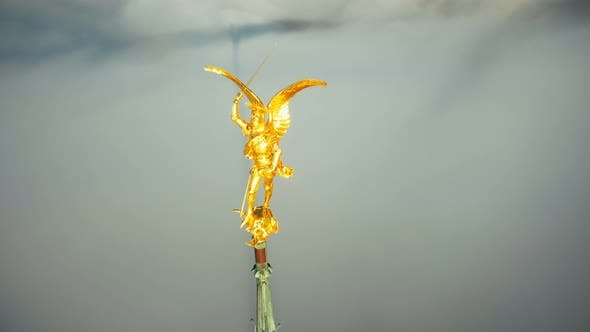 Cover Image for Extreme Aerial Close-up Shot of Heavenly Golden Saint Michael Angel Statue on Mont Saint Michel Sky