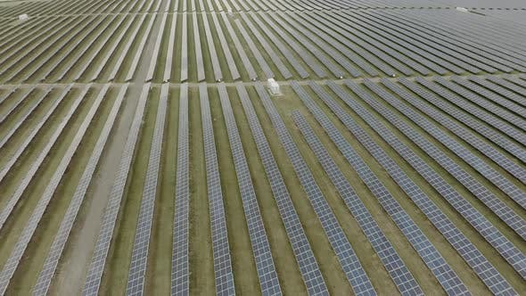 Thumbnail for Aerial View of Large Solar Power Station. Top View, Drone Flies Over Solar Panels Farm. Alternative
