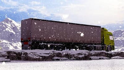 Moving Freight Truck on Snowy Mountainous Rocky Road