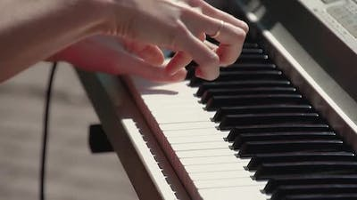 Pianist Plays the Synthesizer As Part of the Band