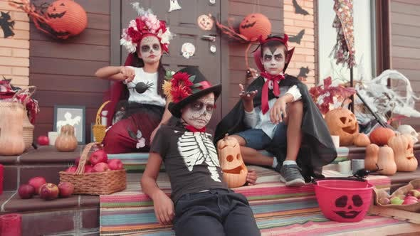 Thumbnail for Children in Costumes Posing on Front Porch on Halloween