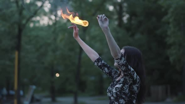 Thumbnail for Grace Beautiful Girl Performing a Show with Flame Standing in Front of Forest