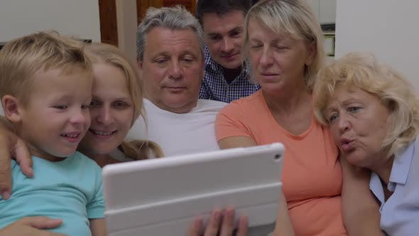 Thumbnail for Family Watching Video on Tablet Computer