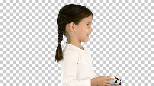 Smiling little girl play videogame holding, Alpha Channel