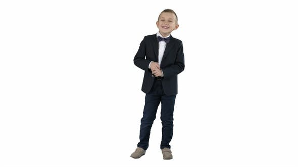 Thumbnail for Little boy in formal outfit talking and smiling on white