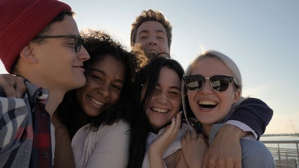 Thumbnail for Smiling students taking selfie in the summer sun.