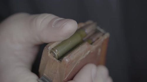 Cartridges Charge. Close-up. Shooting