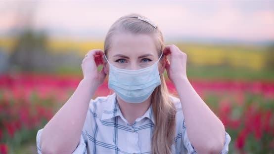 Portrait Of Woman Wearing Face Mask On Field