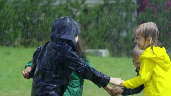 Thumbnail for Kids Playing in Rain