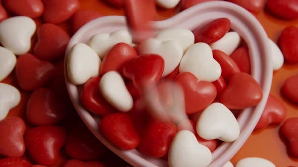 Rotating stock footage shot of Valentines decorations and candies - VALENTINES 0077