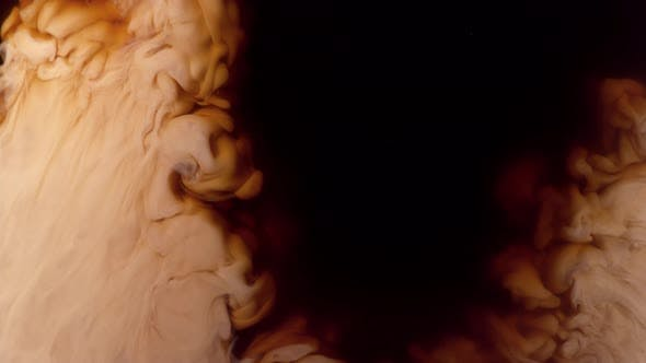 Thumbnail for Coffee creamer swirling in coffee, shot with Phantom Flex 4K at 1000 frames per second