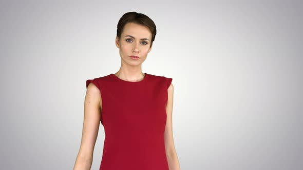 Thumbnail for Girl in a Red Dress, Posing, Straightens Her Dress on Gradient Background