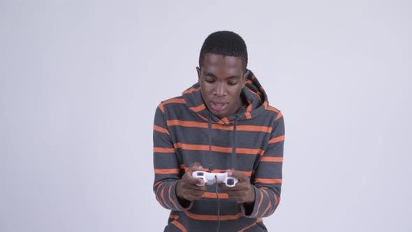 Thumbnail for Young Focused African Man Playing Games