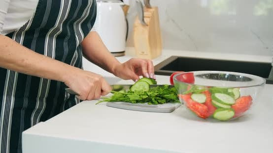 Cover Image for Woman Chopping Salad Closeup