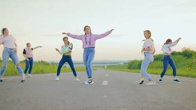 Beautiful Girls Dancing in Nature in Jeans