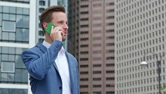 Thumbnail for Businessman talk to smart phone
