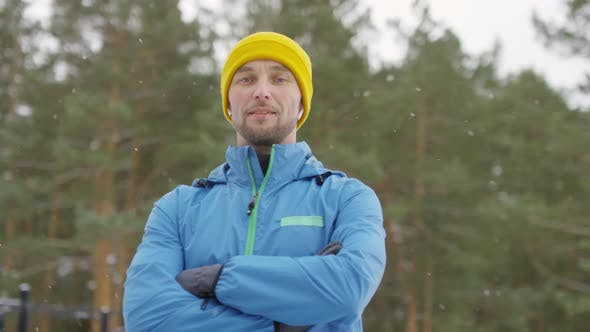 Thumbnail for Confident Man Posing in Forest in Winter