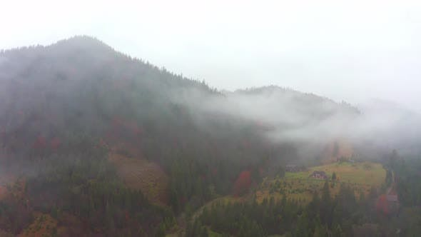 Thumbnail for The Mountain Valley of the Carpathians Is Covered with Fog and Rain in Ukraine Near the Village of