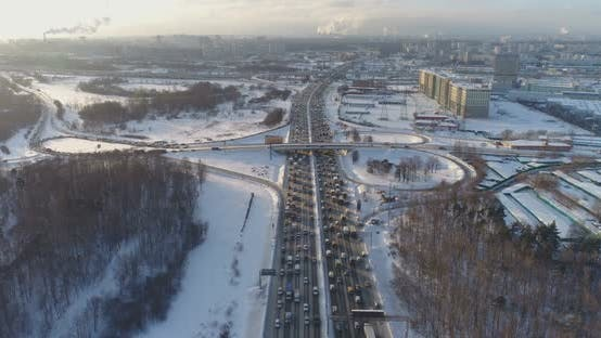 Thumbnail for Cars on Highway at Sunny Winter Morning in the City. Aerial View