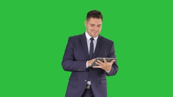 Cover Image for Businessman swiping pages on a tablet and talking to camera