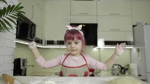 Thumbnail for Cooking Pizza. Little Child Playing with Flour Gets Her Hands Dirty in Kitchen