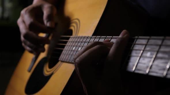 Close up vibrating string acoustic guitar